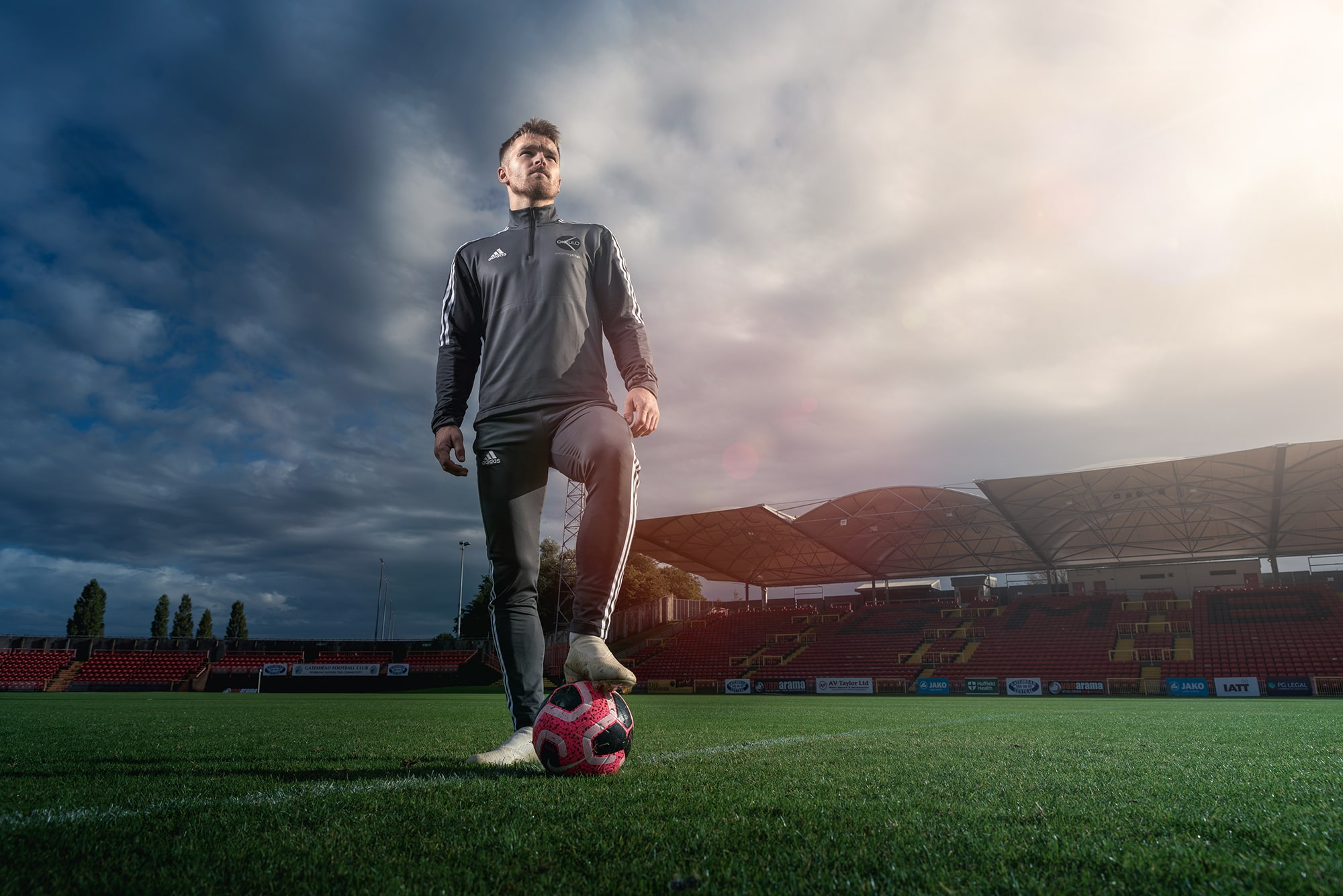 Man Standing with Football under Foot in Gateshead Stadium