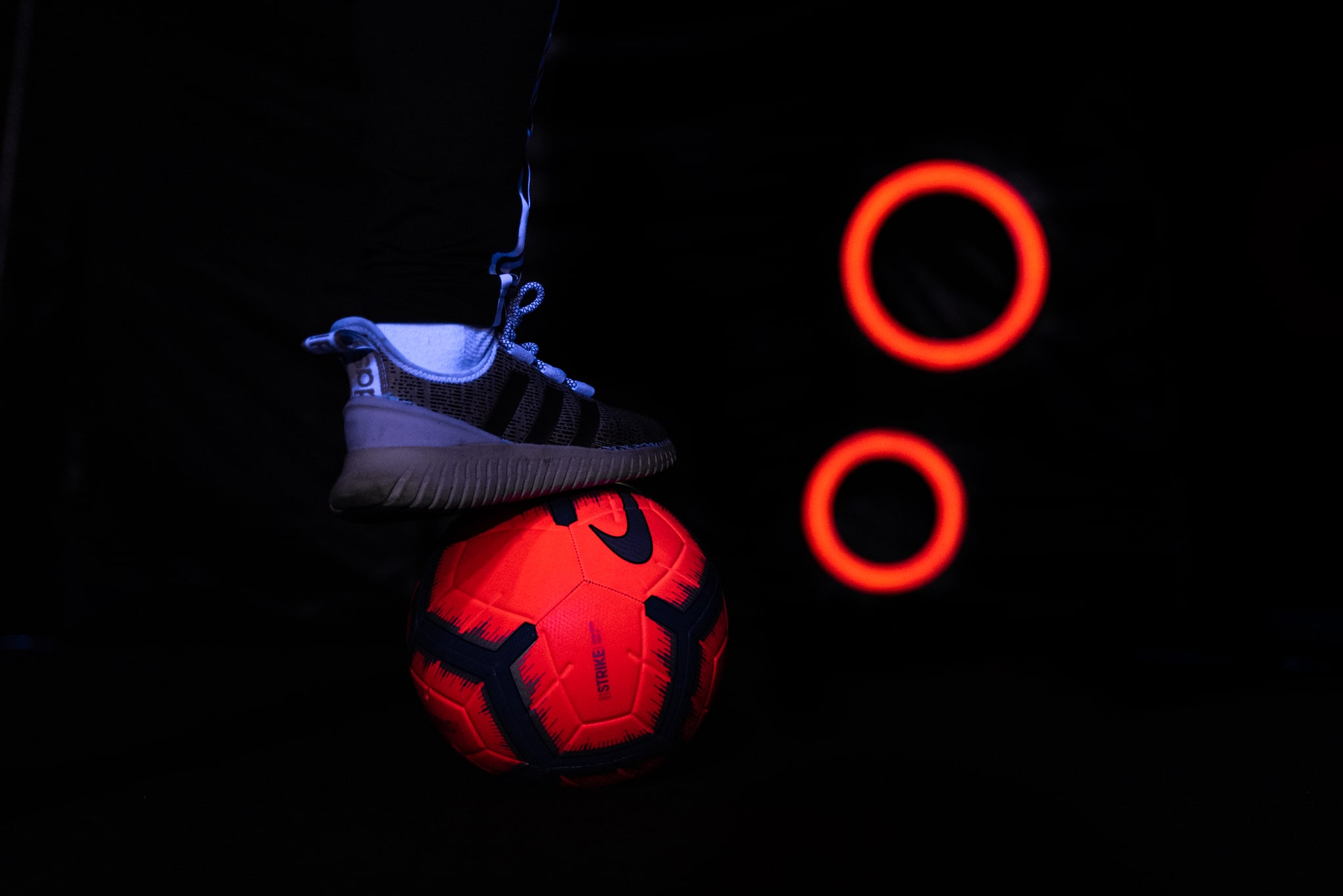 Football Boot with Red Circle Background